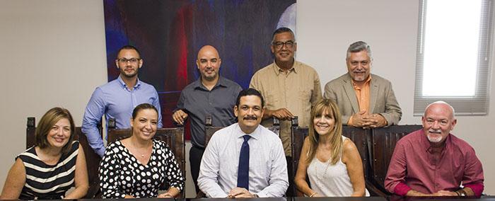 Los directores de los coros de los once recinto de la UPR junto con el presidente de la institución, Uroyoán R. Walker Ramos.