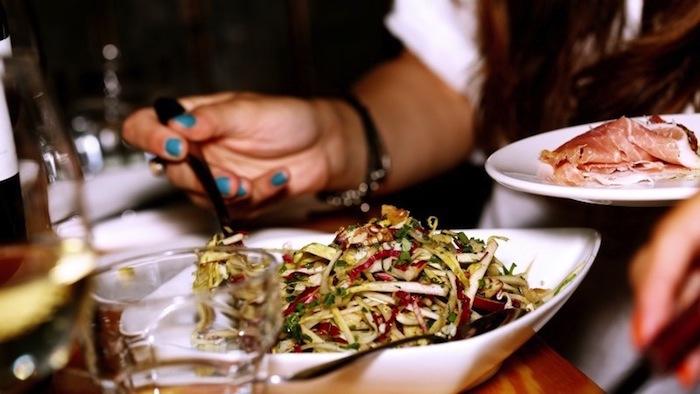 woman-eating-dinner-in-restaurant