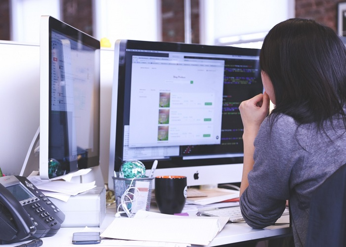 woman-working-on-computer-contemplating-in-office