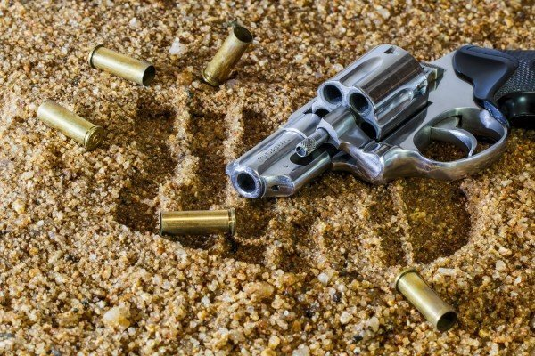 revolver-with-bullets-on-ground