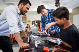 Teacher,With,Male,Pupils,Building,Robotic,Vehicle,In,Science,Lesson